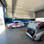 Le tre auto della Scuderia ai box